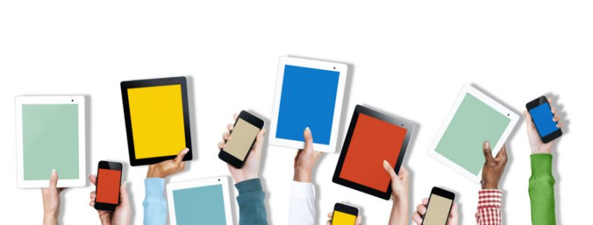 Various hands are raising mobile devices